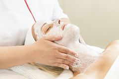 Massage and facial peels at the salon. Using cosmetics Stock Photo