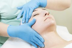 Massage and facial peels at the salon. Using cosmetics Stock Photography