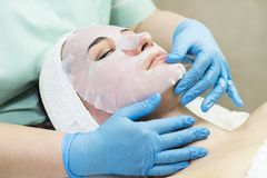 Massage and facial peels at the salon. Using cosmetics Stock Image