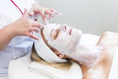 Massage and facial peels at the salon. Using cosmetics Royalty Free Stock Photography