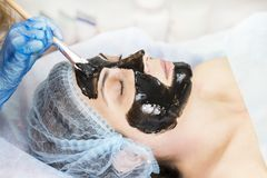 Massage and facial peels at the salon. Using cosmetics Royalty Free Stock Photo