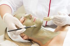 Massage and facial peels at the salon. Using cosmetics Royalty Free Stock Image