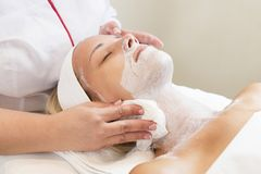 Massage and facial peels at the salon Stock Images