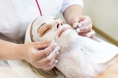 Massage and facial peels at the salon. Using cosmetics Royalty Free Stock Images