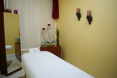 Massage and Facil Room. Massage bed in a calming and cozy room royalty free stock photography