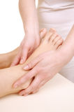 Massage the feet of a young woman Royalty Free Stock Photos