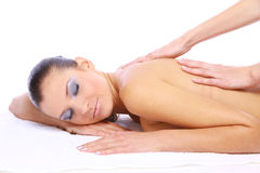 Massage of female back. Spa resort royalty free stock image