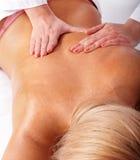 Massage of female back. Royalty Free Stock Images