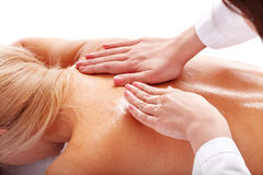 Massage of female back. Royalty Free Stock Photo