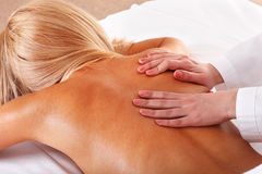 Massage of female back. Spa. Stock Images