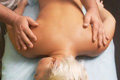 Massage of a female body. Position of hand at massage of a female body Stock Image