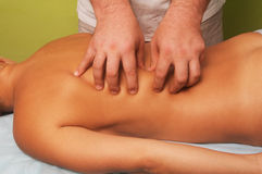 Massage of female body. Position of hand at massage of a female body Royalty Free Stock Photo