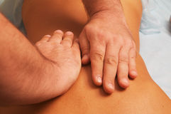 Massage of female body. Position of hands at massage of a female body Stock Photo