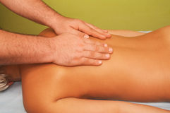 Massage of female body. Position of hands at massage of a female body Royalty Free Stock Photo