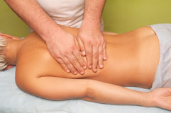 Massage of female body. Position of hands at massage of a female body Royalty Free Stock Photography
