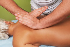 Massage of a female body. Position of hands at massage of a female body Stock Photos