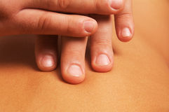 Massage of female body. Position of hands fingers at massage of a female body Stock Images