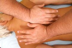 Massage of female body. Position of hands and fingers at massage of a female body Stock Images