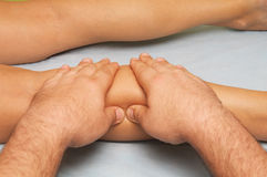 Massage of female body. Position of hands and fingers at massage of a female body Stock Image
