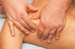 Massage of female body. Position of hands and fingers at massage of a female body Royalty Free Stock Photo