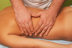 Massage of female body. Position of hands and fingers at massage of a female body Royalty Free Stock Image