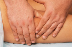 Massage of female body. Position of hands and fingers at massage of a female body Stock Photography