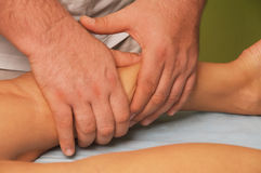 Massage of female body. Position of hands and fingers at massage of a female body Stock Photo