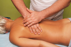Massage of female body. Position of hands and fingers at lymphatic drainage massage of a female body Stock Photos