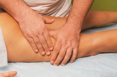 Massage of female body. Position of hands and fingers at lymphatic drainage massage of a female body Stock Image