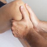Massage of a female calf muscle Royalty Free Stock Image