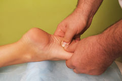 Massage of female foot Stock Images
