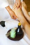 Massage of female foot in spa salon Stock Photo