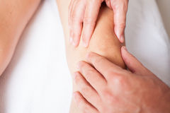 Massage of a female knee Royalty Free Stock Image
