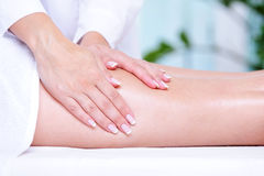Massage of the female leg Stock Photo