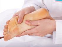 Massage of female leg. Royalty Free Stock Photography