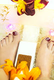 Massage female legs. Massage female legs with the design of the nails in the massage tub stock photography