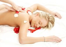 Massage with flower petals Royalty Free Stock Images