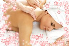 Massage with flowers #2 Royalty Free Stock Photos
