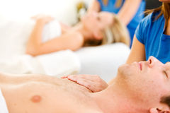 Massage: Focus on Hands. Series of a young couple getting massages by therapists.  Together, as well as separate.  Bright and clean Royalty Free Stock Images