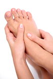Massage of a foot. Stock Images