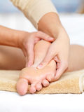 Massage of foot. Close-up massage for foot in spa salon - vertical Royalty Free Stock Image