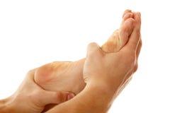 Massage foot female close-up isolated on white Stock Photos