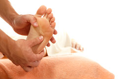 Massage foot female  on white Royalty Free Stock Photos