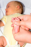 Massage of footstep. Mother making massage to the baby's footstep Stock Photography
