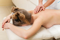 Massage girl in beauty salon Stock Photography