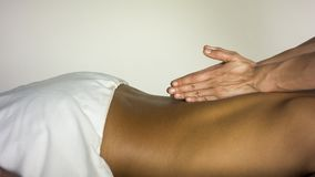 Massage girl makes a guy stock photography