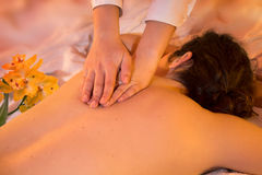 Hands massage whit orchids. Massage - girl on towels with masseuse whit orchids stock photos