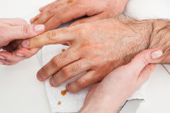 Massage hands. Male massage hands in the manicure room Royalty Free Stock Images