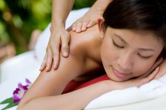 Massage hands Stock Images
