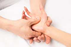 Massage hands at certain points. Hands close-up Royalty Free Stock Photo